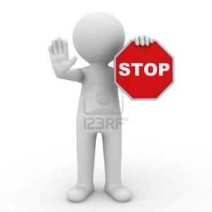 man-holding-stop-sign-on-white-background
